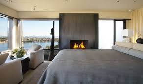 small bedroom fireplace ideas gray upholstery tufted leatherette