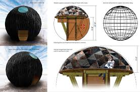 a burnt wood spherical sculpture has arrived on the shores of lake