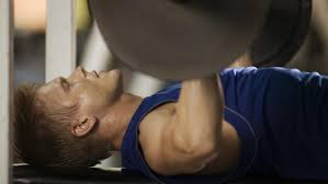 how much should a man be able to bench press based on his body