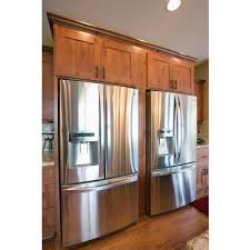 two refrigerators side by side knotty alder cabinets cabin and