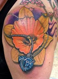 daffodil with aquamarine heart stone by matthew davidson tattoonow