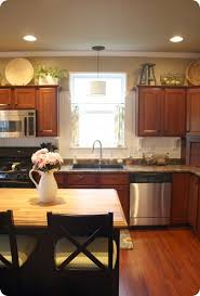 decorating ideas above kitchen cabinets how to decorate above kitchen cabinets from thrifty decor