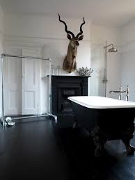 bathroom with black floors and clawfoot tub ways to paint