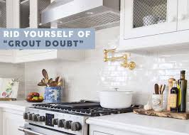 antique white kitchen cabinets with subway tile backsplash the difference grout color can make to your tiles emily