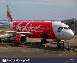 airasia ngurah rai airport air asia airbus plane at ngurah rai international airport dps stock