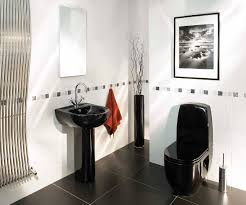 black ceramic freestanding sink and water closet on gray ceramic