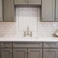 kitchen sink backsplash gray shaker kitchen cabinets with white subway tile herringbone sink