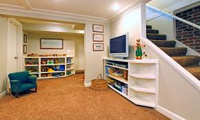 basement tv stand and crown molding with carpet flooring and