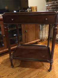 the bombay company 2 tier telephone table with wheels casters for