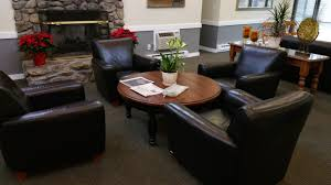 How Much Does A Living Room Set Cost by Living Room Round Silver Leather Pouf Chair White Stain Wall