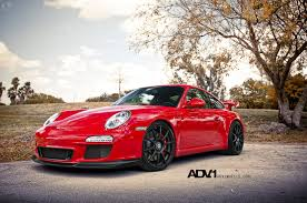 red porsche eye catching red porsche 911 fitted with custom accessories