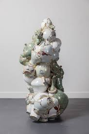 shattered porcelain fragments fused with gold by artist