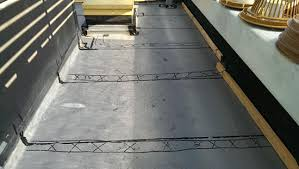 concrete slab on pan decking prior to installing a roof boston ma