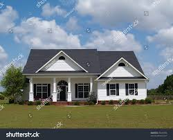 one story residential home board siding stock photo 30618784