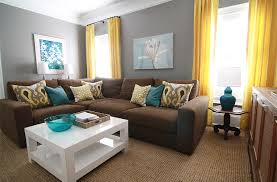 gray walls brown couch and teal accents not sure about yellow