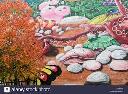 huge wall mural next to tree with autumn colours london ontario huge wall mural next to tree with autumn colours london ontario canada