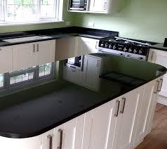 grey kitchen units with black granite worktops black granite worktop granite that works