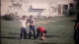 Kids Playing Backyard Football 2705 Boys Play Football In The Backyard At Home Vintage