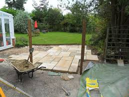 paved patio and trellis partition ammonite paving u0026 landscaping