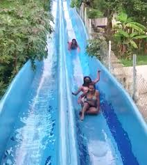 two girls stuck on waterslide and get annihilated by third person