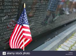 Washington Dc Flag An American Flag In Front Of Vietnam War Memorial In Washington Dc