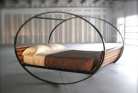 awesome rocking bed design made of iron and wood with unique shape