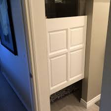 single swinging poplar cafe door used in a bathroom bathroom