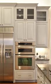 merillat u0027s new shale grey painted cabinets are a mainstay trend in
