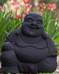 laughing buddha statues in sand colors the