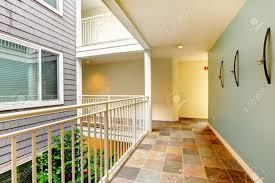 modern apartment building hallway and door near railing stock