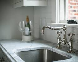 Colored Kitchen Faucet White And Gray Kitchen Designed By Jackbilt Homes Home Bunch