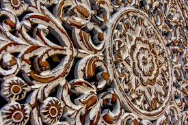 wood carving with floral motifs and ornaments as decoration stock