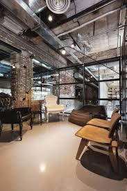 industrial office features exposed bricks u0026 concrete ceilings
