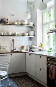 kitchen with shelves no cabinets by camilla krishnashwamy white kitchen kitchens and dining