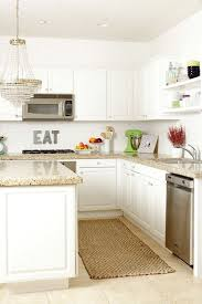 white kitchen cabinets with tile floor does your floor tile to match your countertop or surround