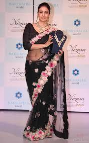 tabu in black transparent saree