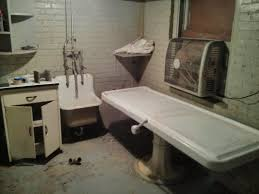 this is the embalming room of a small funeral home in disuse