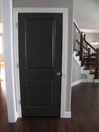 we used behr black suede flat on all of our doors in our home