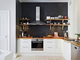 black wall no backsplash open timber shelves against rangehood