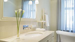 how to design your bathroom sneaky tricks to make your bathroom look bigger