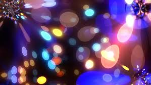 blurred blue lights of a garlands colorful lamps square of city