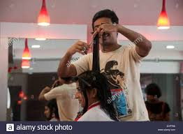 woman getting hair cut in a hair beauty salon india stock photo