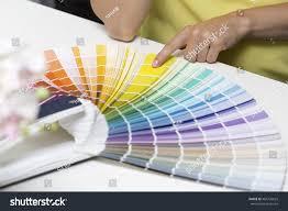 woman choosing paint color tone samples stock photo 466726625