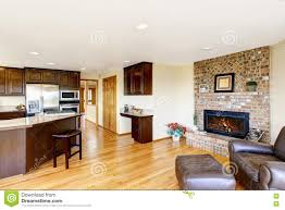 open floor plan kitchen and living room with brick fireplace