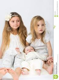 Little Girls Clothing Stores Little Girls And A Baby Boy In White Clothes Sitting Royalty Free