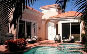 courtyard homes florida styles in home design courtyard homes lanai outdoor kitchen