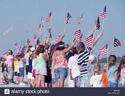 Pensacola Flag Group Of Young Patriotic Children Waving American Flags Stock