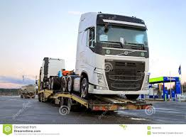 2014 volvo truck new volvo fh trucks transported on a semi trailer editorial image