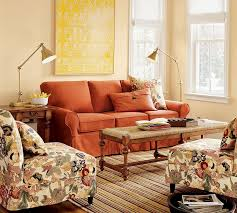 striped area rug also rustic coffee table feat comfortable orange