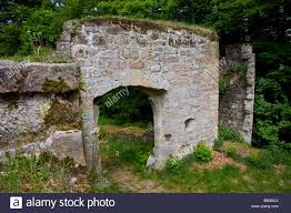 wall of an old castle in german forest stock photo royalty free